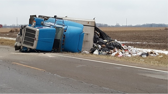 Rollover crash sends 2 to hospital in Champaign County
