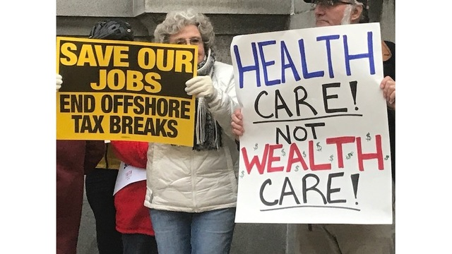 Rally against GOP tax bill held outside U.S. Rep. Mike Turner's office