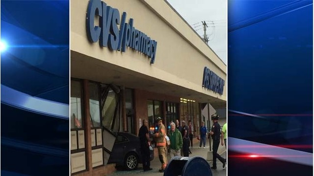 car crashes into pharmacy store in kettering