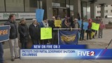 Sen. Portman takes steps to end government shutdown as rally is held outside his Columbus office